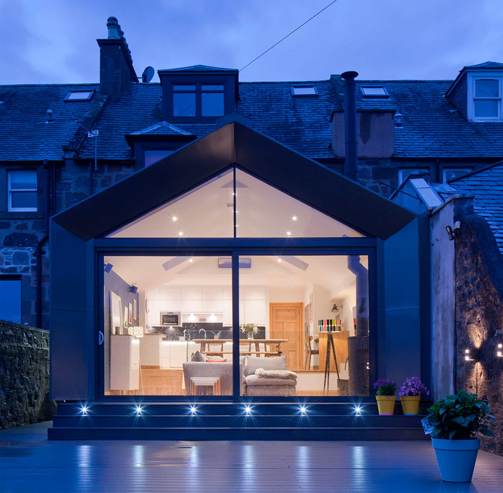 Spacious house extension lit up by blue light