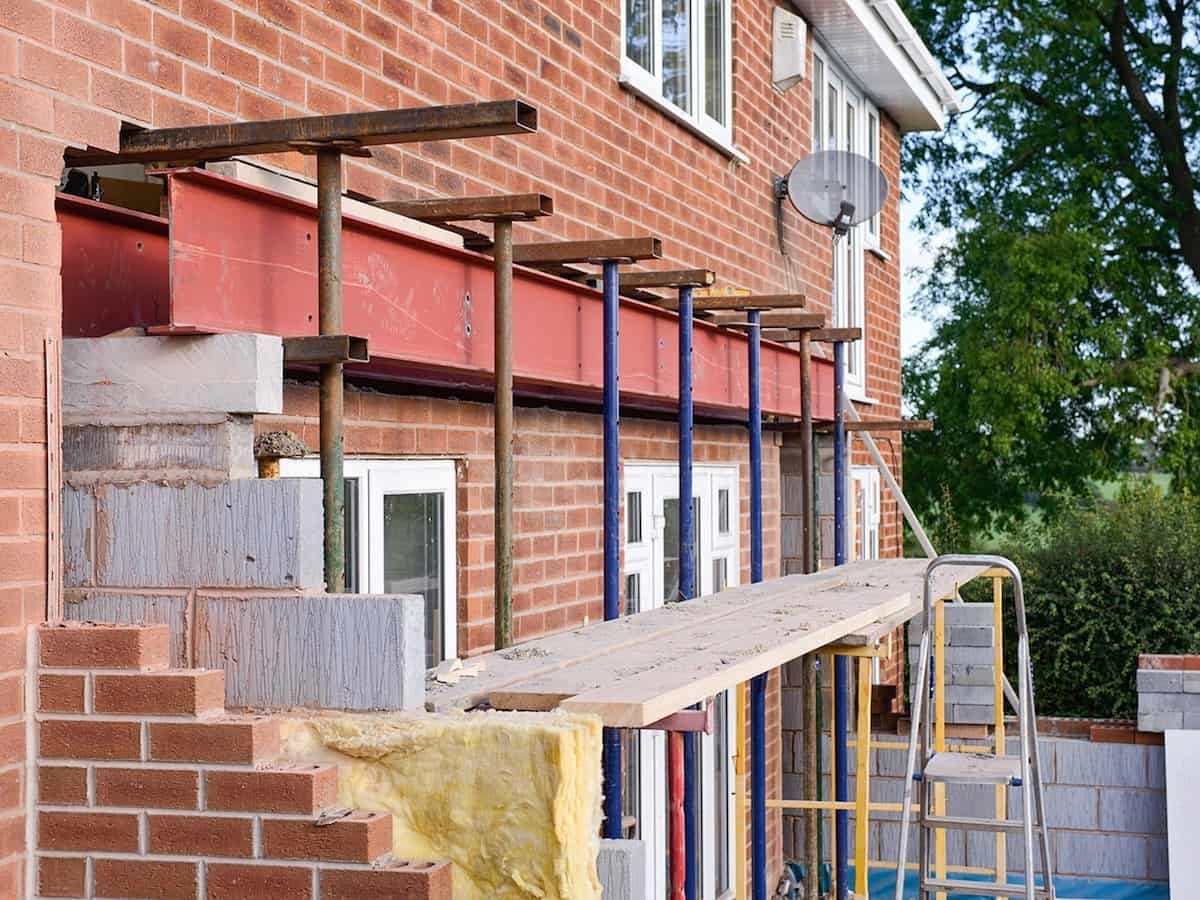 Building work being carried out on the party wall of a flat