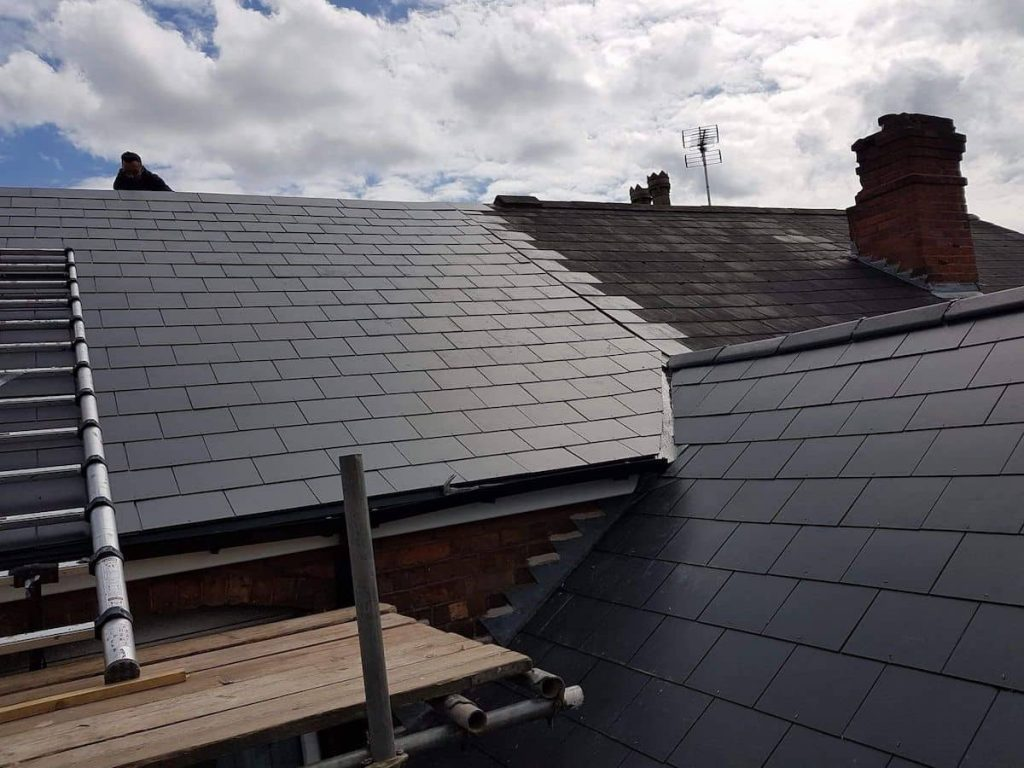 Roofers in Romford working on a slate roof replacement