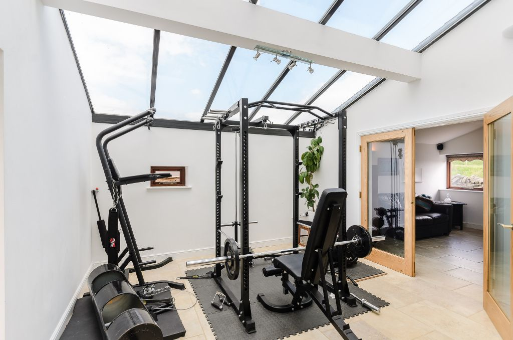 Loft home gym with heavy equipment